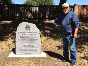 Image: Phil Valdez stands next to a Campsite Marker in Morgan Hill